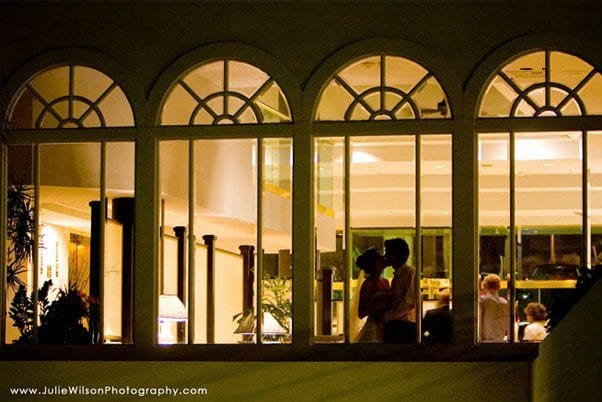Weddings at The Cliffs Resort - Bride and groom kissing in the window