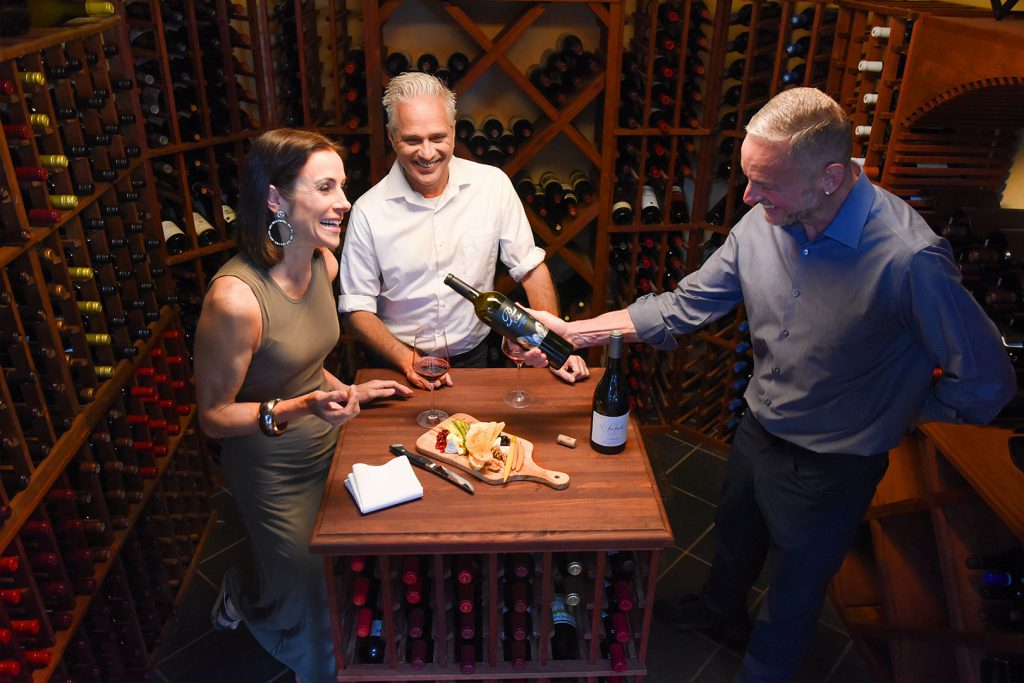 18206-tcr-couple-laughing-in-wine-cellar