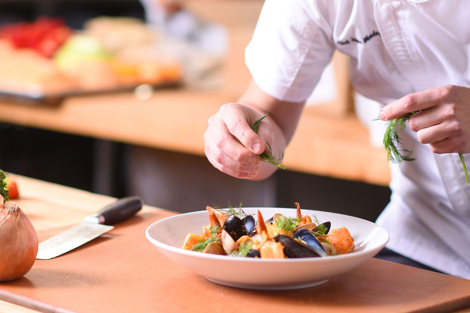 18206-tcr-marisol-chef-with-paella-garnishing